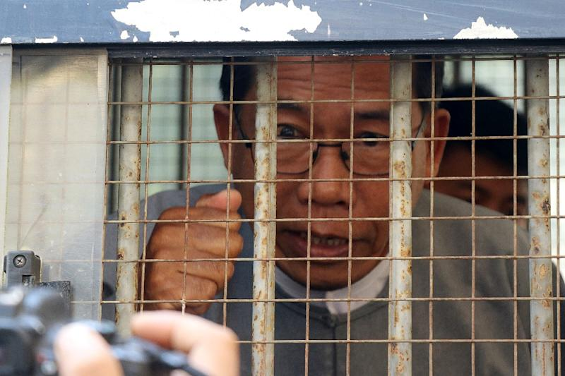 Security forces tried to calm hundreds of supporters outside the court in Rakhine state capital Sittwe as Aye Maung was escorted to a waiting police van following the verdict (AFP Photo/STR)