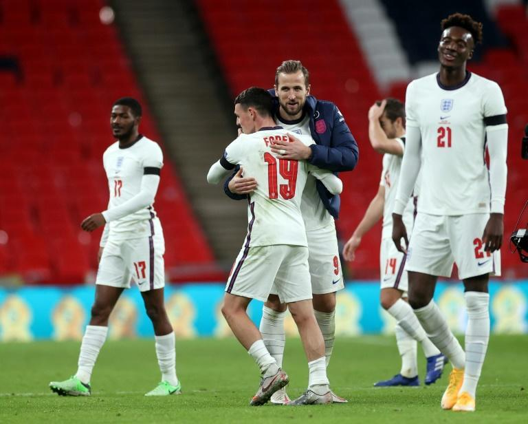 Phil Foden celebrates with Harry Kane after netting twice in England's big win over Iceland