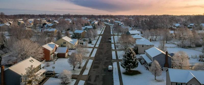 Snowy morning down the street - looking down the street from the air with a drone at the suburban neighborhood after a new snow in Dayton, Ohio