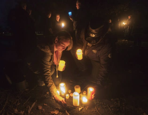 Fans of the Tragically Hip gather for a candlelight vigil by the water's edge in Bobcaygeon Ont. on Wednesday to pay tribute to singer Gord Downie who died on Tuesday night at the age of 53.