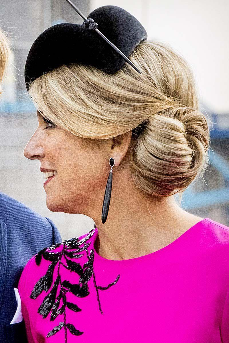 <p>Queen Maxima of The Netherlands looked nothing short of regal with side swept bangs pulled into chic twisted bun.</p>