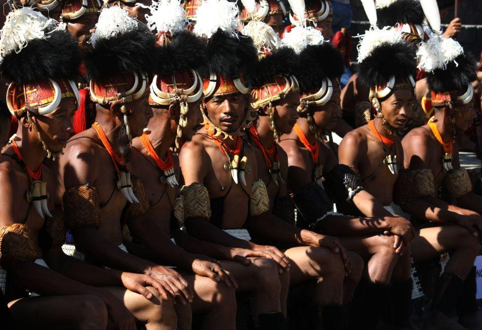 Naga tribesmen from the Yimchunger tribe wait to perform.