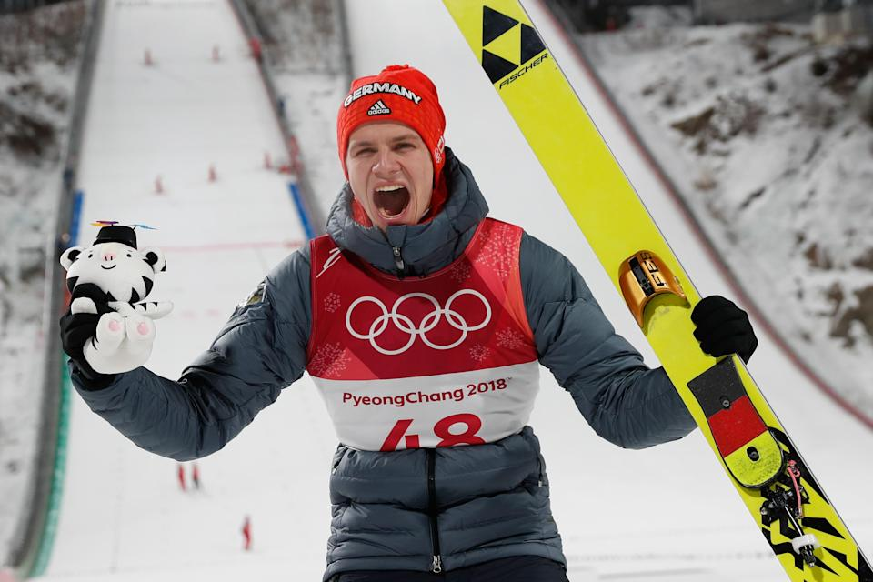 <p>Germany's Andreas Wellinger celebrates during the victory ceremony after winning the men's normal hill individual ski jumping event during the Pyeongchang 2018 Winter Olympic Games on February 10, 2018, in Pyeongchang. / AFP PHOTO / Odd ANDERSEN </p>
