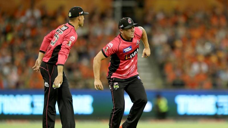 Steve O'Keefe pulls up lame after fielding a ball in the Sydney Sixers' BBL loss in Perth.