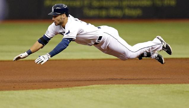 Tampa Bay Rays' Kevin Kiermaier dives into second base with a double in the first inning of a baseball game against the Toronto Blue Jays Saturday, July 12, 2014, in St. Petersburg, Fla. (AP Photo/Mike Carlson)