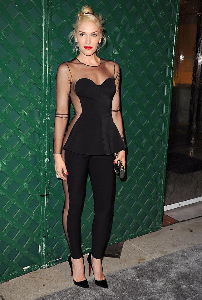 "Gwen Stefani showed off her curves (and quite a bit of skin!) on Friday night in L.A.at the Stella McCartney boutique, where the designer's dad, former Beatle Paul McCartney, premiered the music video for his new song, ""My Valentine."" What do you think of the No Doubt singer's slinky jumpsuit, which was paired with a purposely messy topknot, bold red lips, and black Christian Louboutin ""Pigalle"" pumps? Hot or not? (4/13/2012)"