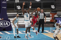 New Orleans Pelicans guard Eric Bledsoe (5) tries to shoot over Charlotte Hornets center Bismark Biyombo (8) during the second half of an NBA basketball game Sunday, May 9, 2021, in Charlotte, N.C. (AP Photo/Brian Westerholt)