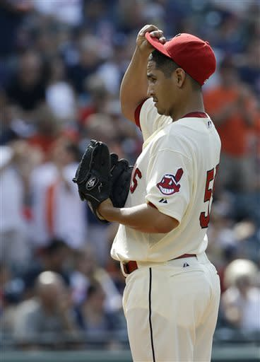 Cleveland Indians starting pitcher Carlos Carrasco reacts after Detroit Tigers' Miguel Cabrera hit a two-run home run in the third inning of a baseball game, Saturday, July 6, 2013, in Cleveland. Austin Jackson scored. (AP Photo/Tony Dejak)