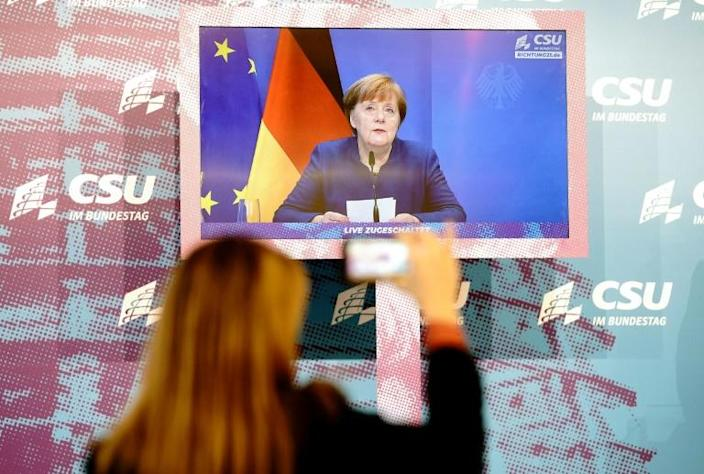 """Merkel said Thursday she was """"furious and saddened"""" by the events at the US Capitol"""