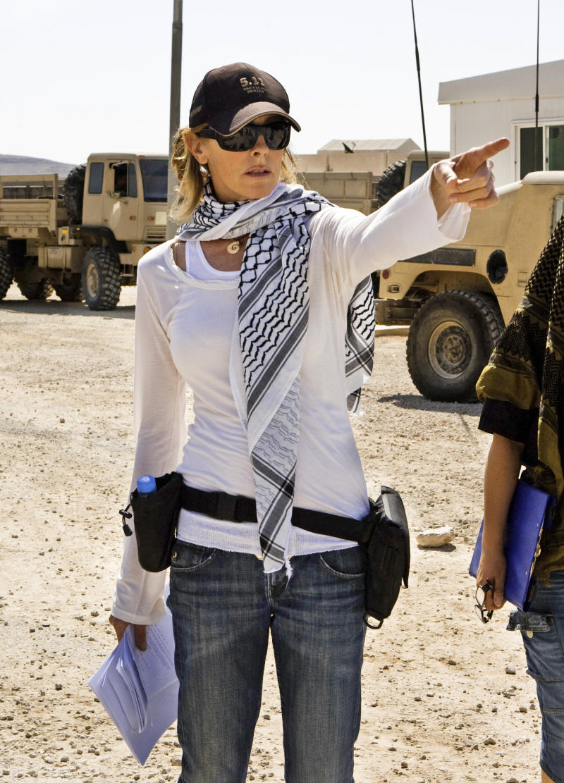 """In this film publicity image released by Summit Entertainment, director Kathryn Bigelow, center, is shown on the set of """"The Hurt Locker."""" With the announcement of Osama Bin Laden's death in Pakistan, uncertainty surrounds Bigelow's latest film in development about an attempt to kill the infamous al-Qaida leader. (AP Photo/Summit Entertainment)"""