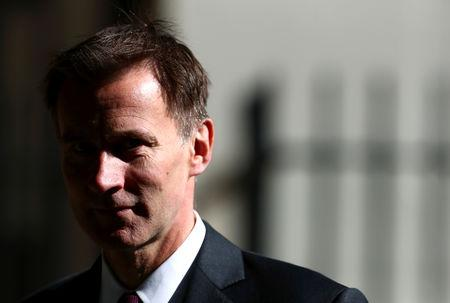 FILE PHOTO:  Britain's Foreign Secretary Jeremy Hunt is seen outside Downing Street in London