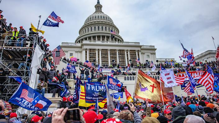 Supporters of President Trump storm the U.S. Capitol Building Wednesday. (Evelyn Hockstein/For The Washington Post via Getty Images)