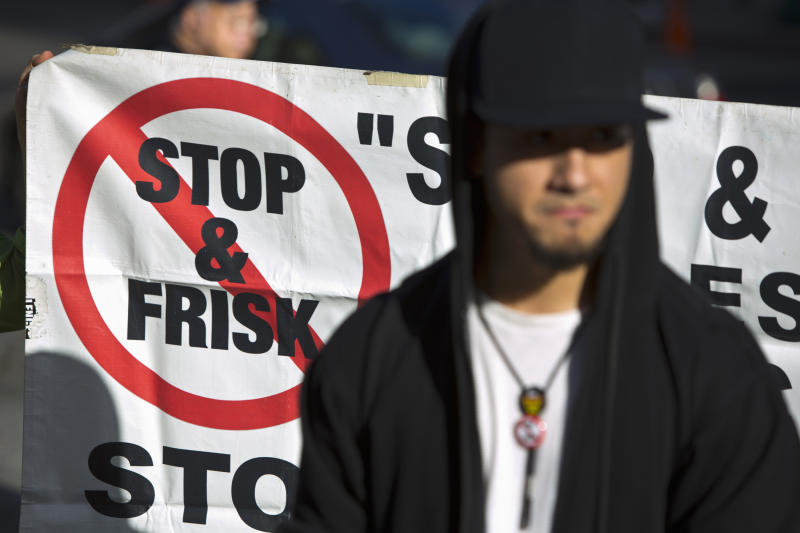 People attend a news conference against the Stop-and-Frisk program, outside the Federal Court in New York
