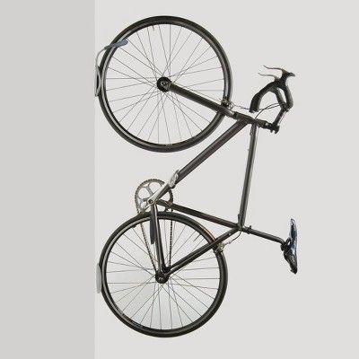 """<p><strong>Delta Design</strong></p><p>target.com</p><p><strong>$15.79</strong></p><p><a href=""""https://www.target.com/p/delta-design-single-bike-wall-mount-rack-with-tray/-/A-10489298"""" rel=""""nofollow noopener"""" target=""""_blank"""" data-ylk=""""slk:Shop Now"""" class=""""link rapid-noclick-resp"""">Shop Now</a></p><p>Save space by hanging your bike using this single bike rack. Made of powder-coated steel, this bike storage solution can hold up to 40 pounds if installed correctly. A built-in tire tray, which can hold tire rims up to 2.5 inches, will keep the tracks off the wall.</p>"""