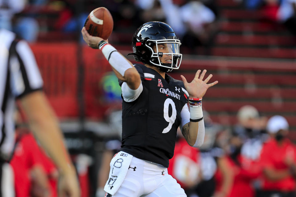 FILE - Cincinnati quarterback Desmond Ridder throws a pass during the first half of an NCAA college football game against Houston in Cincinnati, in this Saturday, Nov. 7, 2020, file photo. Ridder returns for his senior season, looking to add to his 6,905 career passing yards and 57 career touchdowns, but also to take on more of a leadership role. (AP Photo/Aaron Doster, File)