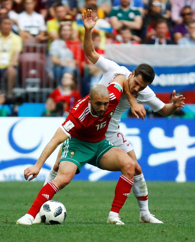Soccer Football - World Cup - Group B - Portugal vs Morocco - Luzhniki Stadium, Moscow, Russia - June 20, 2018 Morocco's Nordin Amrabat in action with Portugal's Cedric Soares REUTERS/Kai Pfaffenbach