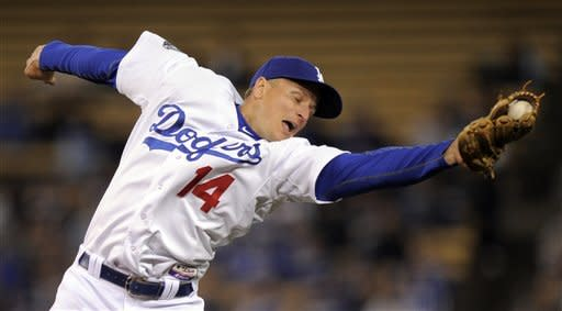Los Angeles Dodgers second baseman Mark Ellis makes a catch on a ball hit by Pittsburgh Pirates' Pedro Alvarez during the seventh inning of a baseball game, Wednesday, April 11, 2012, in Los Angeles. (AP Photo/Mark J. Terrill)