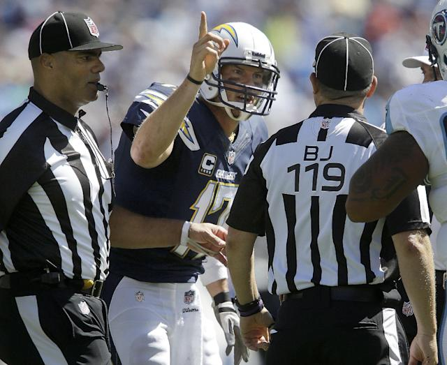 San Diego Chargers quarterback Philip Rivers (17) argues with back judge Greg Wilson (119) after offensive pass interference was called against the Chargers in the second quarter of an NFL football game against the Tennessee Titans on Sunday, Sept. 22, 2013, in Nashville, Tenn. Rivers was penalized for unsportsmanlike conduct as a result. (AP Photo/Mark Zaleski)