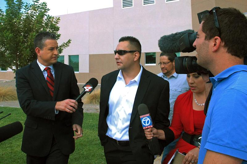 In this July 16, 2013 photo, Levi Chavez, 32, walks out of Sandoval District Court in Bernalillo, N.M., after a jury acquitted him of murdering his wife, 26-year-old Tera Chavez, in 2007 and making it look like a suicide. The jury's decision came after more than 10 hours of deliberations and a month long trial detailing Chavez's many affairs, charges of a botched investigation and allegations of a police cover-up. (AP Photo/Russell Contreras)