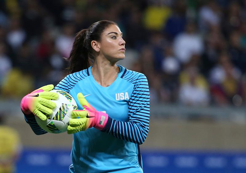 FILE - In this Aug. 3, 2016, file photo, United States' goalkeeper Hope Solo takes the ball during a women's soccer game at the Rio Olympics against New Zealand in Belo Horizonte, Brazil. U.S. women's national team coach Jill Ellis has emphasized that Solo's suspension stemmed from a 'sum total of actions' and not just comments the goalkeeper made about Sweden during the Olympics. (AP Photo/Eugenio Savio, File)