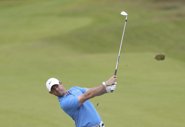 Northern Ireland's Rory McIlroy plays a shot on the 8th fairway during a practice round ahead of the start of the British Open golf championships at Royal Portrush in Northern Ireland, Tuesday, July 16, 2019. The British Open starts Thursday. (AP Photo/Peter Morrison)