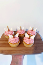 """<p>These unicorn <a href=""""https://www.delish.com/uk/cooking/recipes/a29286353/butterfly-cupcakes/"""" rel=""""nofollow noopener"""" target=""""_blank"""" data-ylk=""""slk:cupcakes"""" class=""""link rapid-noclick-resp"""">cupcakes</a> are an adorable way to <a href=""""https://www.delish.com/uk/cooking/recipes/g28783985/easy-baking-recipes-for-kids/"""" rel=""""nofollow noopener"""" target=""""_blank"""" data-ylk=""""slk:bake with kids"""" class=""""link rapid-noclick-resp"""">bake with kids</a>, or for a fun <a href=""""https://www.delish.com/uk/cooking/recipes/a32090325/funfetti-cake-birthday-cake-recipe/"""" rel=""""nofollow noopener"""" target=""""_blank"""" data-ylk=""""slk:birthday cake"""" class=""""link rapid-noclick-resp"""">birthday cake</a> idea. Rather than messing about with fondant for the horn, we've gone with a candle. And those ears? Well, they're just mini marshmallows - genius! You can have a <a href=""""https://www.delish.com/uk/cooking/recipes/a28829469/perfect-vanilla-cupcakes-recipe/"""" rel=""""nofollow noopener"""" target=""""_blank"""" data-ylk=""""slk:basic vanilla sponge"""" class=""""link rapid-noclick-resp"""">basic vanilla sponge</a> if you wish, but we've opted for a <a href=""""https://www.delish.com/uk/cooking/recipes/a29286353/butterfly-cupcakes/"""" rel=""""nofollow noopener"""" target=""""_blank"""" data-ylk=""""slk:funfetti filling"""" class=""""link rapid-noclick-resp"""">funfetti filling</a>.</p><p>Get the <a href=""""https://www.delish.com/uk/cooking/recipes/a32640091/unicorn-cupcakes/"""" rel=""""nofollow noopener"""" target=""""_blank"""" data-ylk=""""slk:Unicorn Cupcakes"""" class=""""link rapid-noclick-resp"""">Unicorn Cupcakes</a> recipe.</p>"""