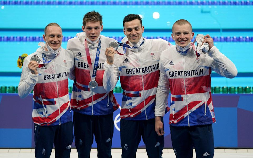 Luke Greenbank, Duncan Scott, James Guy and Adam Peaty show off their silver medals - PA