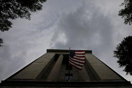 A U.S. flag flies at the headquarters of the Department of Justice in Washington