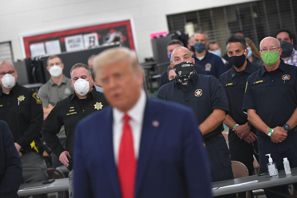 US President Donald Trump speaks with officials on September 1, 2020, at Mary D. Bradford High School in Kenosha, Wisconsin. - Trump visited Kenosha, the city at the center of a raging US debate over racism, despite pleas to stay away and claims he is dangerously fanning tensions as a reelection ploy.