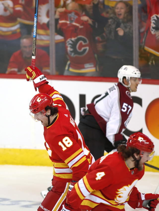 Calgary Flames defenseman Rasmus Andersson (4) celebrates his power-play goal against the Colorado Avalanche with left wing James Neal (18) during the second period of Game 2 of an NHL hockey first-round playoff series Saturday, April 13, 2019, in Calgary, Alberta. (Jeff McIntosh/The Canadian Press via AP)