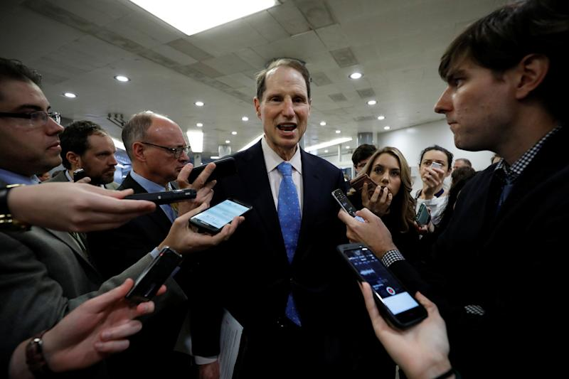Senator Ron Wyden (D-OR) speaks with reporters ahead of the party luncheons on Capitol Hill in Washington, U.S. December 5, 2017. REUTERS/Aaron P. Bernstein