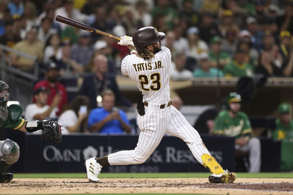 San Diego Padres' Fernando Tatis Jr. watch his home run to left field against the Oakland Athletics in the third inning of a baseball game Tuesday, July 27, 2021, in San Diego. (AP Photo/Derrick Tuskan)