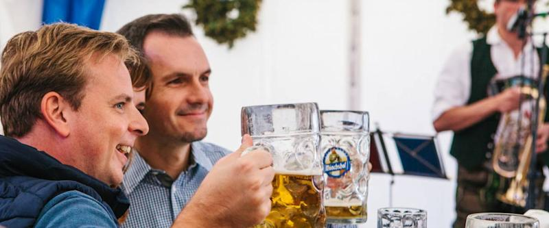 Prague, September 23, 2017: Celebrating the traditional German beer festival called Oktoberfest in the Czech Republic. Friends rejoice and drink fresh German beer together.