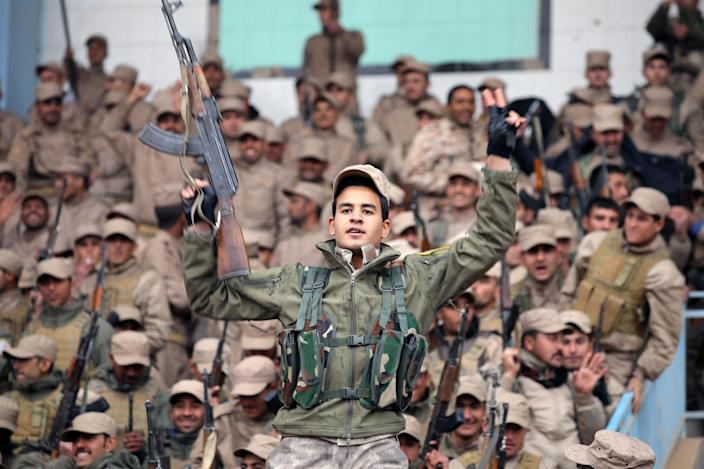 A fighter from the self-defense forces of the Kurdish-led north holds his weapon during a rally in Hasakah, northeastern Syria, Jan. 23, 2018. (Photo: Rodi Said/Reuters)