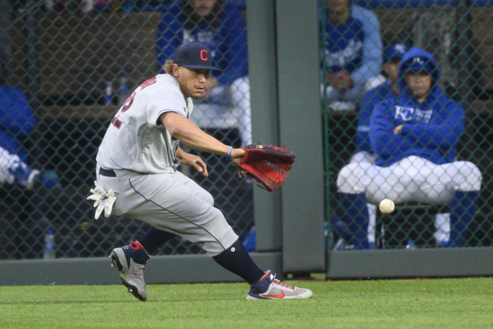 Cleveland Indians left fielder Josh Naylor fields a single by Kansas City Royals' Whit Merrifield during the first inning of a baseball game Monday, May 3, 2021, in Kansas City, Mo. (AP Photo/Reed Hoffmann)