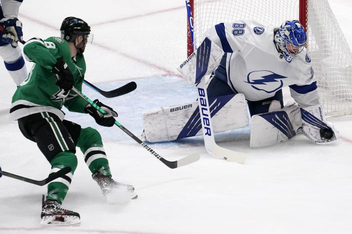 Dallas Stars center Jason Dickinson (18) looks on as Tampa Bay Lightning's Andrei Vasilevskiy (88) gloves a shot in the second period of an NHL hockey game in Dallas, Tuesday, March 2, 2021. (AP Photo/Tony Gutierrez)