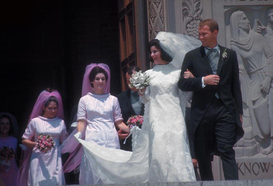 <p>Bridesmaids in the late '60s were told to think pink as the Pepto-Bismol hue gained popularity towards the end of the decade. Bonus points for a matching veil.</p>