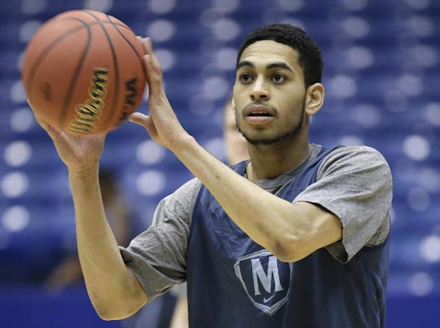 Mount St. Mary's guard Julian Norfleet catches a ball during practice for an NCAA college basketball tournament game, Monday, March 17, 2014, in Dayton, Ohio. Albany plays Mount St. Mary's on Tuesday in a first round game. (AP Photo/Al Behrman)