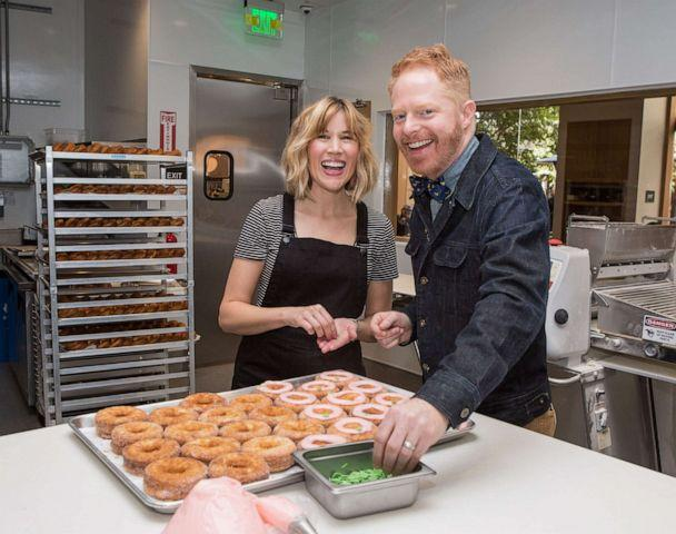 PHOTO: Julie Tanous and Jesse Tyler Ferguson pose at the brand new Dominique Ansel Bakery at The Grove on Nov. 18, 2017 in Los Angeles. (Tiffany Rose/Getty Images for Caruso, FILE)