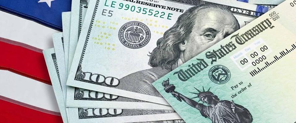 United States Treasury check with US currency. Coronavirus economic impact stimulus payments or IRS tax refund.