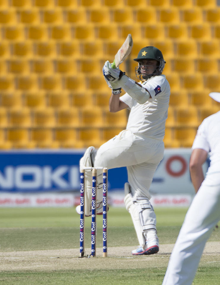 Pakistan batsman Saeed Ajmal plays bats on the third day of their first Test against South Africa at the Sheikh Zayed Cricket Stadium in Abu Dhabi on October 16, 2013. South Africa lost four top-order batsmen against a spirited Pakistan and they now need another 121 runs to avoid an innings defeat and concede the lead in the two-Test series. AFP PHOTO/STR        (Photo credit should read STR/AFP/Getty Images)