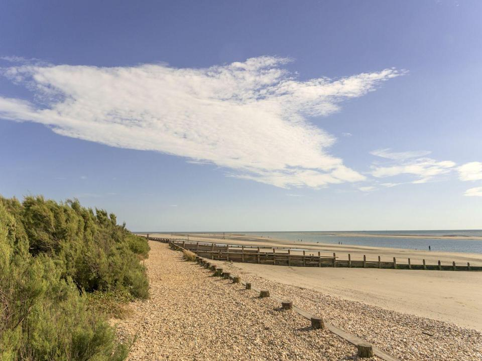 "<p>West Wittering is a long and narrow beach with an open stretch of sand, backing onto Solent and Chichester harbour. Its popular with windsurfers and swimmers, and at low tide there are pools for paddling. Beautiful! </p><p><a class=""link rapid-noclick-resp"" href=""https://www.airbnb.co.uk/"" rel=""nofollow noopener"" target=""_blank"" data-ylk=""slk:FIND AN AIRBNB"">FIND AN AIRBNB</a></p>"