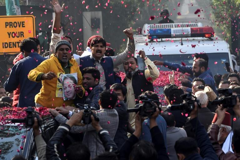 Party workers showered rose petals on Nawaz Sharif's car as it left his house in Lahore