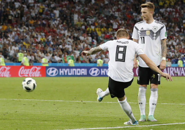 Germany's Toni Kroos, left, scores his side's second goal during the group F match between Germany and Sweden at the 2018 soccer World Cup in the Fisht Stadium in Sochi, Russia, Saturday, June 23, 2018. (AP Photo/Frank Augstein)