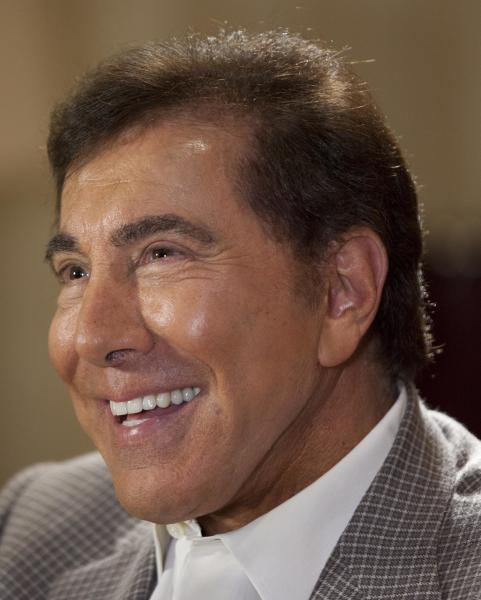 "FILE - In this April 27, 2011 file photo, Steve Wynn is interviewed in Las Vegas. Wynn and porn producer Joe Francis faced off before jurors Tuesday, Sept. 4, 2012, with the casino mogul denying that he threatened to kill the ""Girls Gone Wild"" founder and saying the accusation is threatening his upscale casinos. (AP Photo/Julie Jacobson, File)"