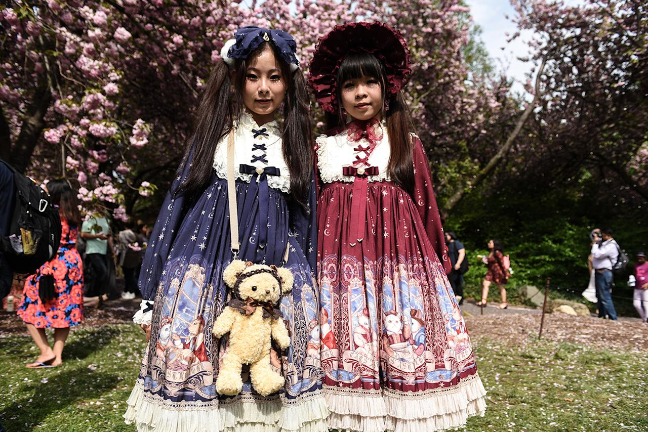 <p>Milky Lin, left ,19 and friend Camellia Zhong, 18, participate in the BBG Parasol Society Fashion Show, which celebrates Lolita-style fashion, at the Brooklyn Botanic Garden's Cherry Blossom Festival, April 29, 2017, in New York. The Brooklyn Botanic Garden is famous for their cherry blossoms, which typically bloom at the end of April and attract thousands of visitors. (Photo: Stephanie Keith/Getty Images) </p>
