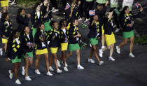Brazil's athletes carry the national and British flags during the Opening Ceremony at the 2012 Summer Olympics, Friday, July 27, 2012, in London. (AP Photo/Paul Sancya)