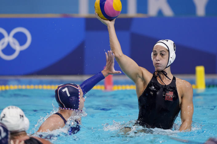 Alena Serzhantova (7), of the Russian Olympic Committee, defends against United States' Margaret Steffens (6) during a preliminary round women's water polo match at the 2020 Summer Olympics, Friday, July 30, 2021, in Tokyo, Japan. (AP Photo/Mark Humphrey)