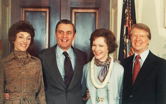 Jimmy Carter, right, and Rosalynn Carter, second from right, pose with Vice President Walter Mondale and wife, Joan Mondale, - AP