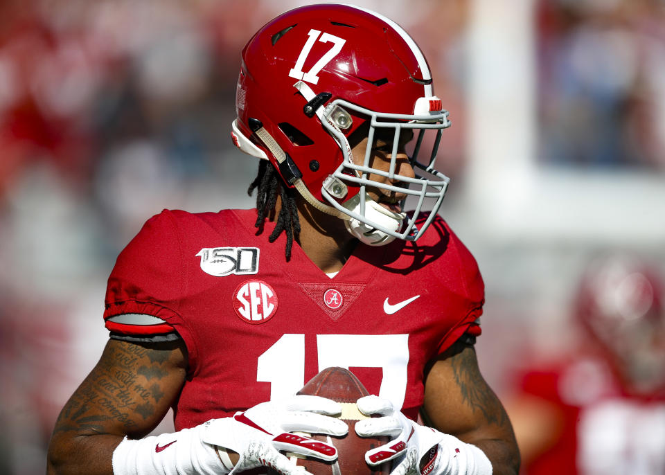 Alabama WR Jaylen Waddle could play in the national title game, but it's not a mortal lock he enters the 2021 NFL draft. (Photo by Todd Kirkland/Getty Images)